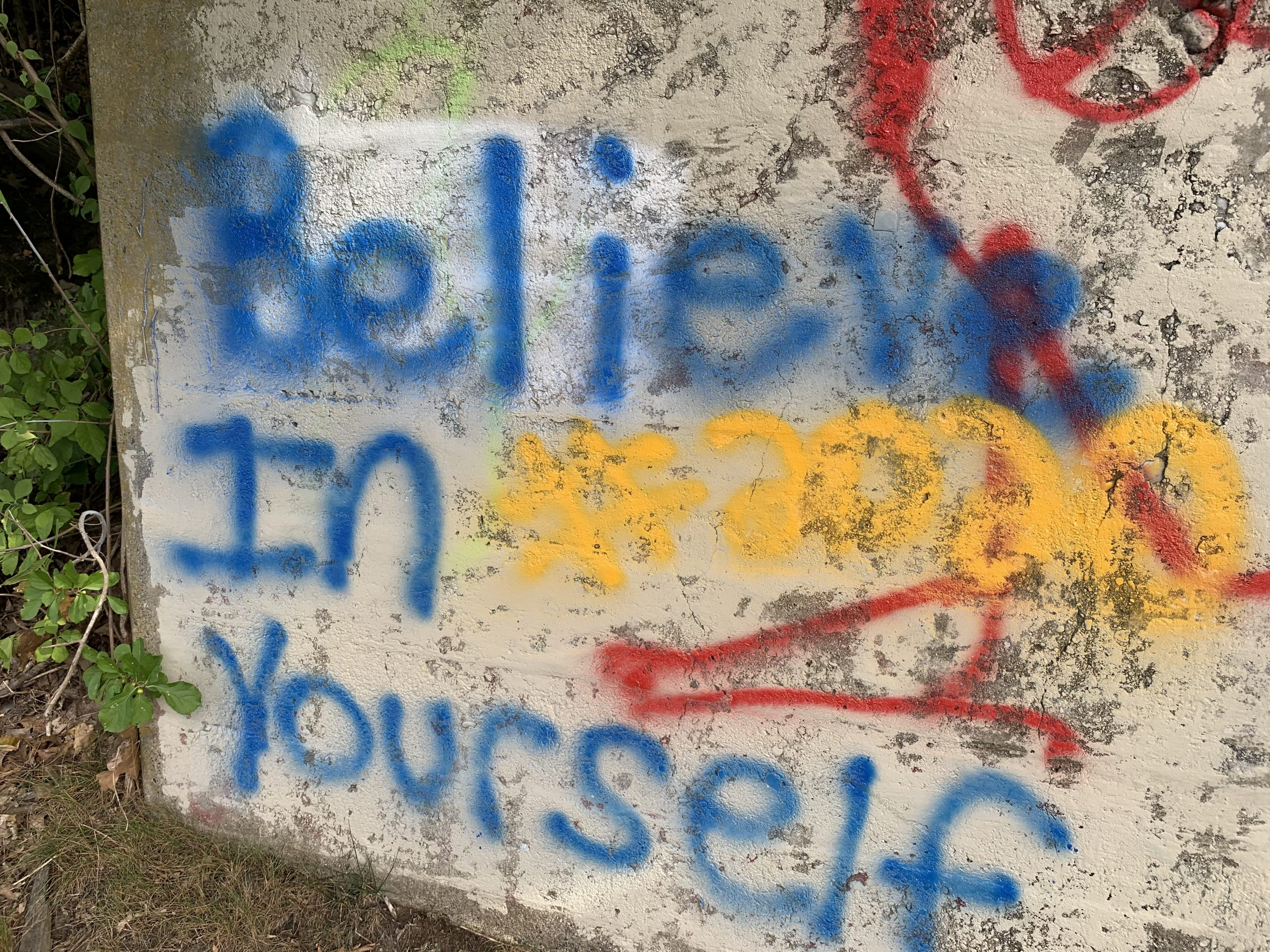 Graffiti stating, 'believe in yourself' found along the canal rail trial in Turner's Falls, MA.