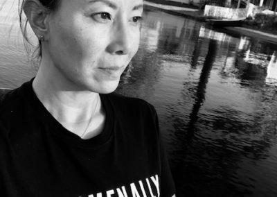 Headshot t of Ramona Piretti, Public Educator of English Literature in West Hartford, CT. Wearing T-shirt that reads, Phenomenally Asian.