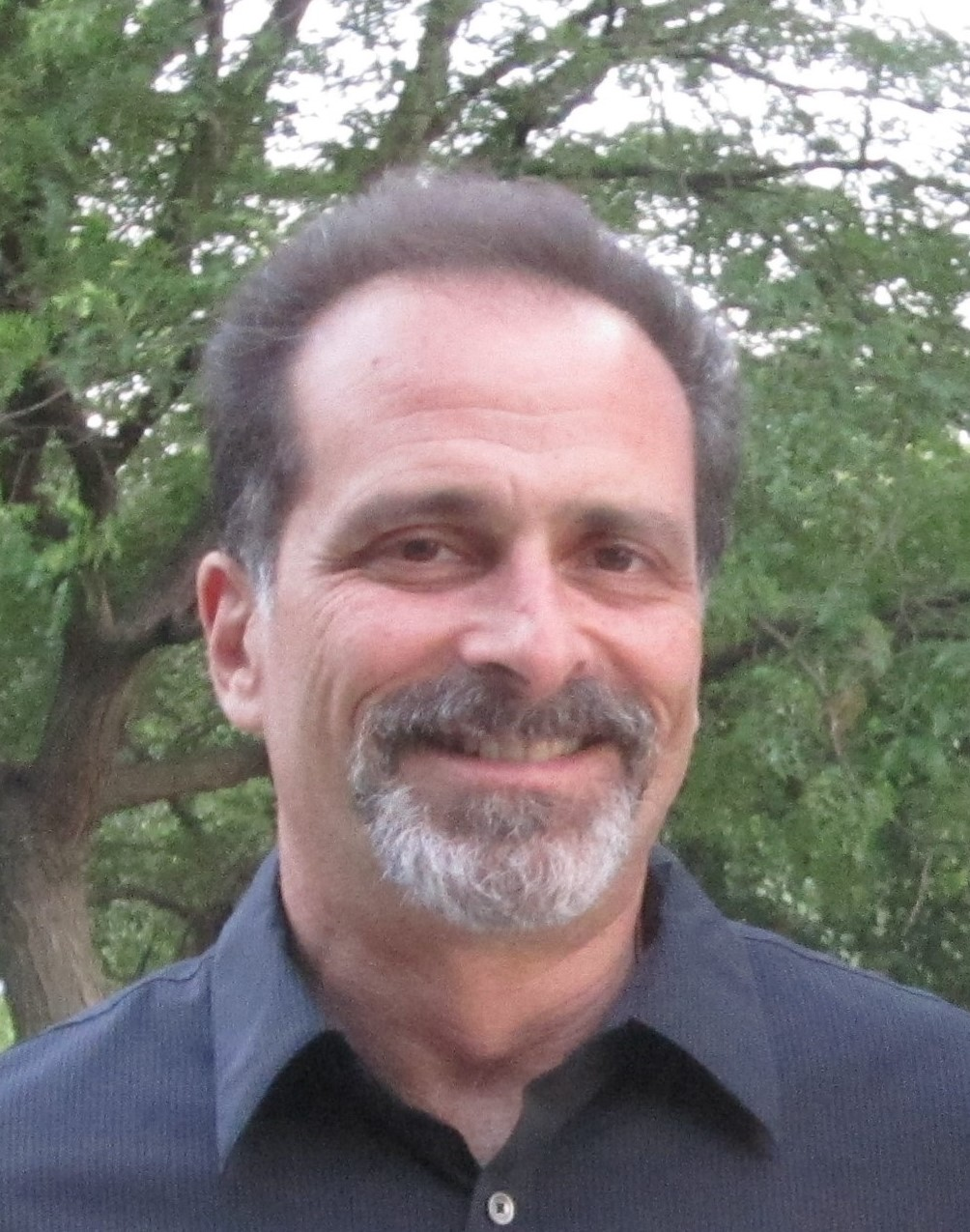 Headshot of Mitch Tyson, former CEO, entrepreneur and climate advocate
