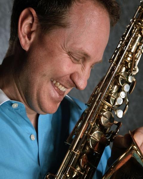Headshot, closeup informal Scott M. Graves in profile with Tenor Saxophone in hand