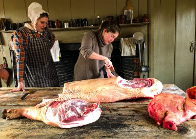 Food & Architecture contributor Victoria Pardo, butchering a hogtied at Old Sturbridge Village, Sturbridge, MA