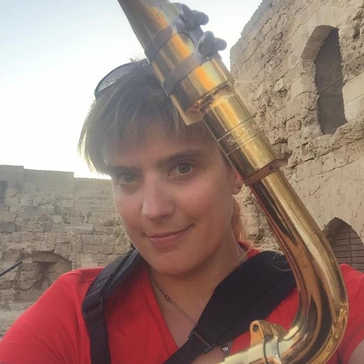 Head-On shot of Baritone Sax Player Melanie Howell Brooks in Cyrpus