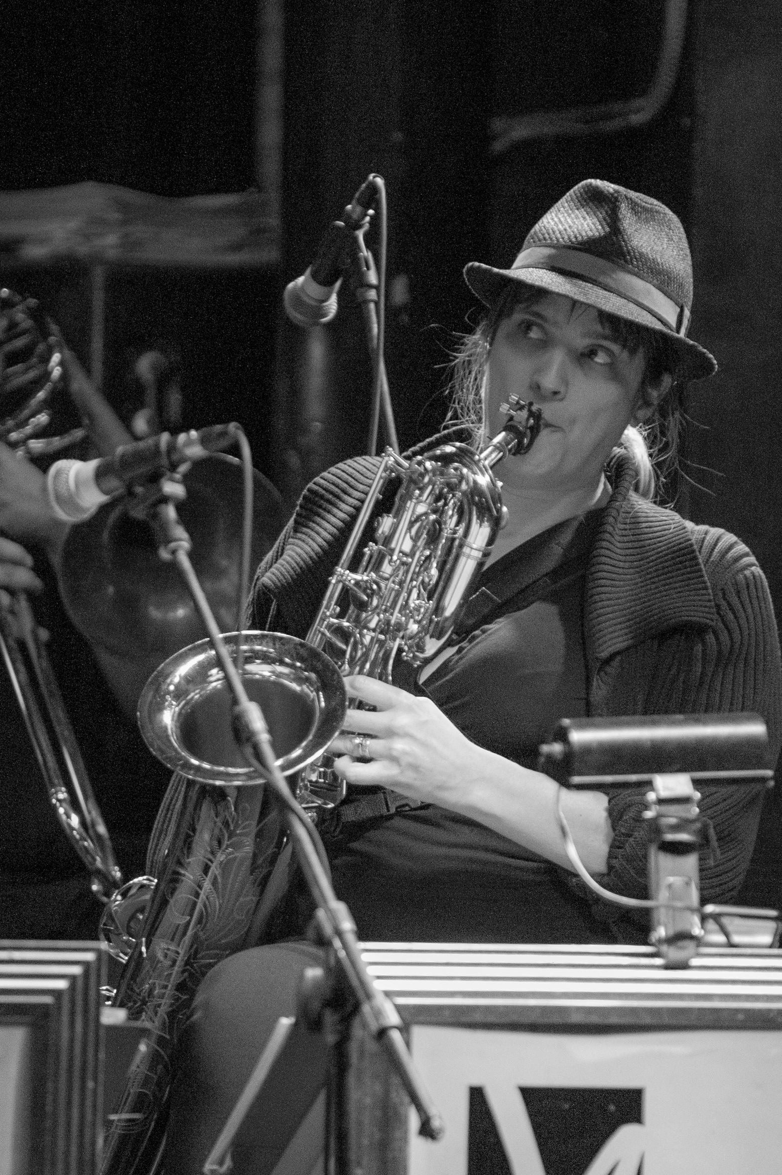 Performance picture in black and white of baritone saxophonist Melanie Howell Brooks