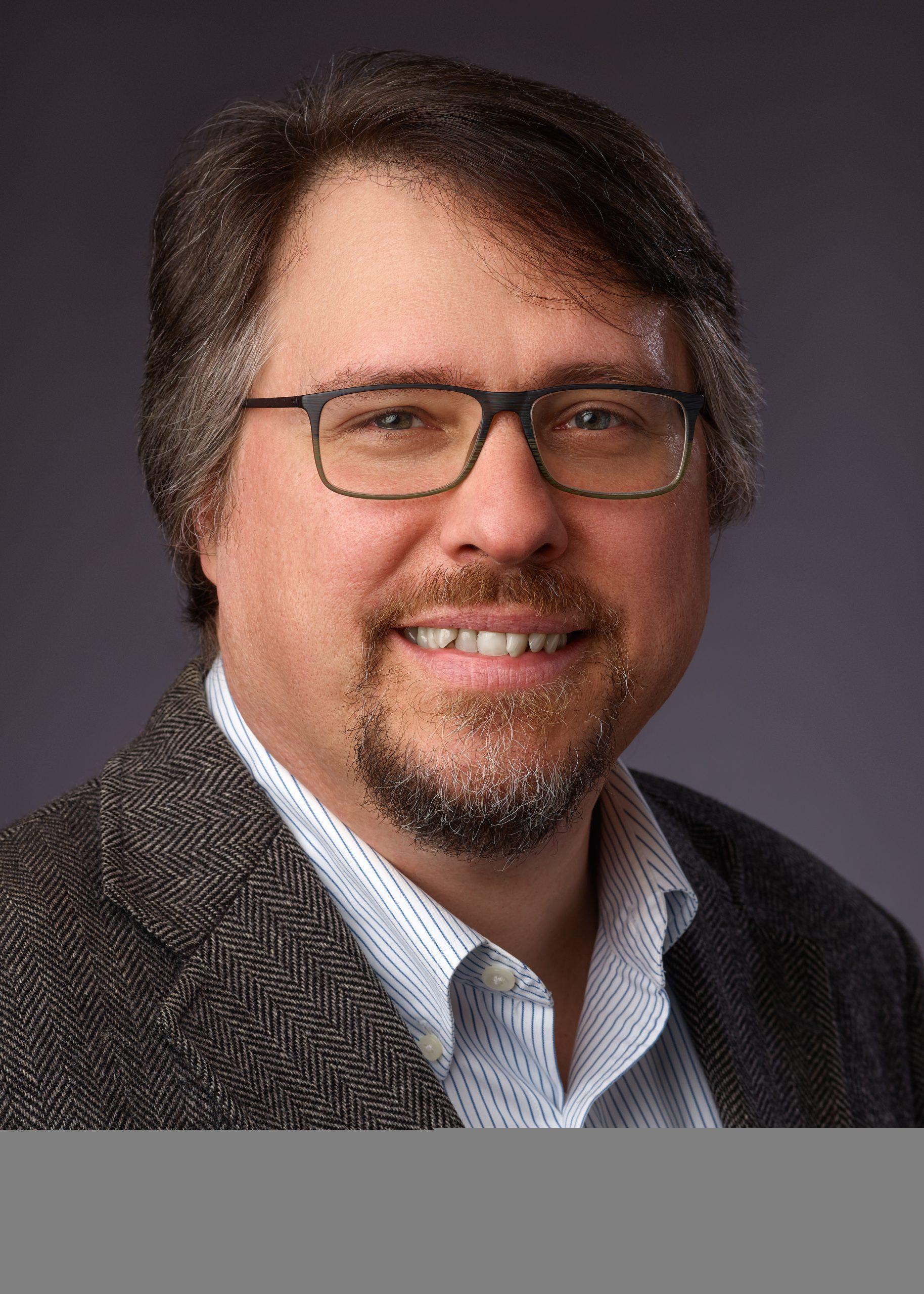 Full color Headshot of Author David Vermette