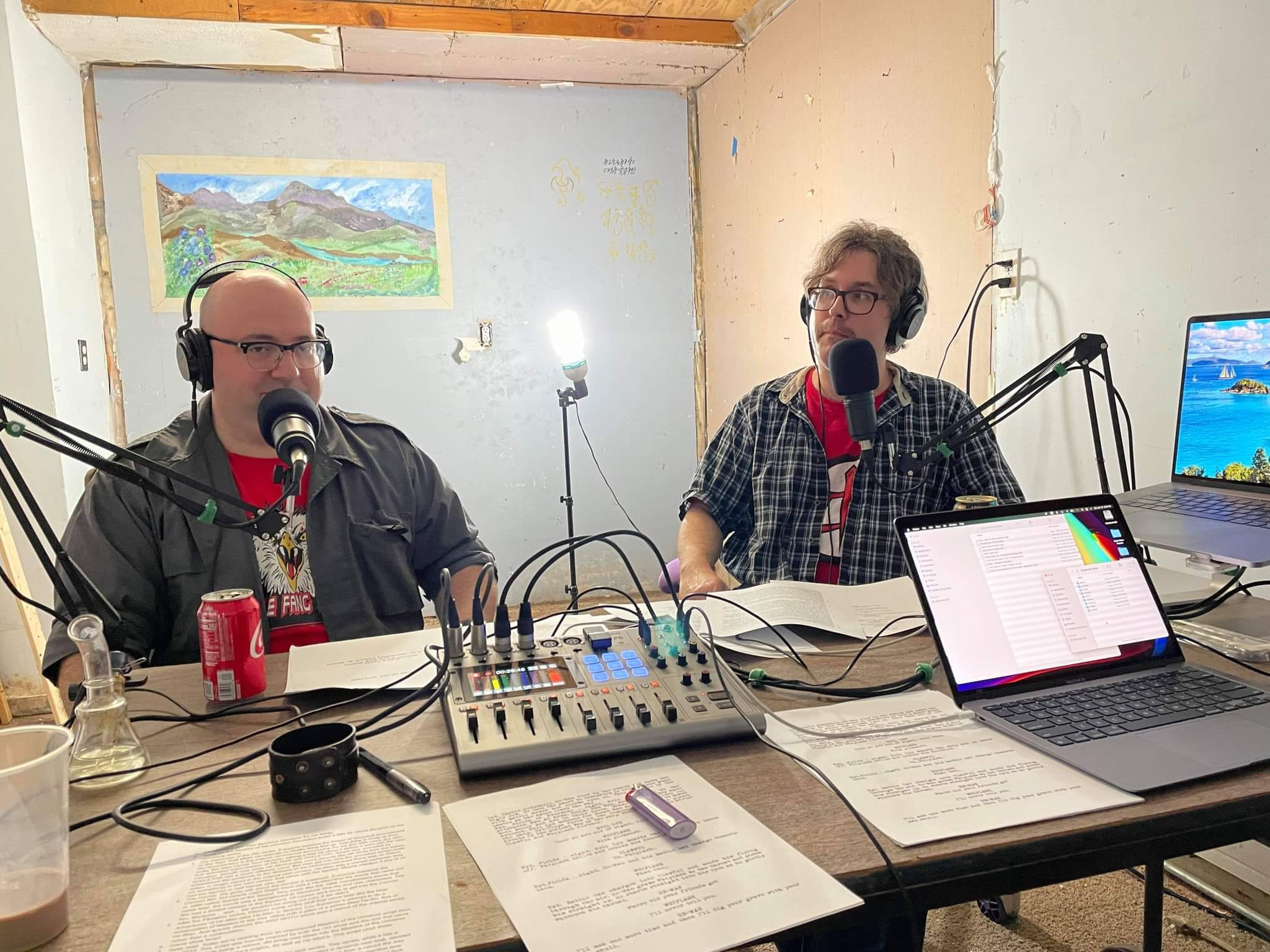 Full color image of Mental Suppository podcast host Bret Herheloz and co-host Eric Shanley recording in their work space in Worcester, MA