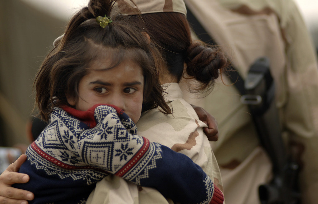 Public Domain. Full color image of Afghani Girl sign airlifted out of country during 2021 Withdrawal of US troops